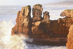 pancake rock canyon at western coast in new zealand - stock photo