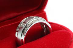 wedding diamond ring in red box - stock photo