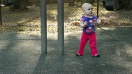 Cute baby girl playing at the park Stock Footage