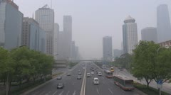Heavy traffic in Beijing in foggy day, CBD, China - stock footage