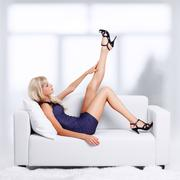 blond girl on sofa - stock photo