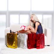 blond girl on sofa - stock photo