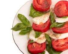 mozzarella with tomatoes and basil leaves - stock photo