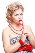 blonde woman with lollipop - stock photo