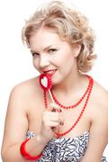 Blonde woman with lollipop Stock Photos