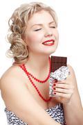 woman with chocolate bar - stock photo
