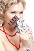 Stock Photo of woman with chocolate bar