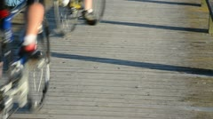 Couple cyclist male female riding bicicle wooden lake bridge Stock Footage