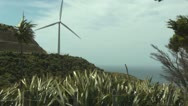 Stock Video Footage of Wind turbine on hillside, windy