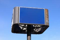 Blue Sign before a Cloudless Sky - stock photo