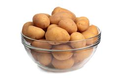 Young potatoes in glass dish Stock Photos