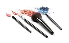 Cosmetic brushes and eyeshadows Stock Photos