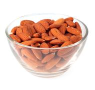 Almonds in glass plate Stock Photos