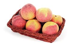 peaches in basket - stock photo