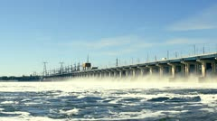 Reset of water at hydroelectric power station on the river - stock footage