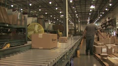 Panoramic view of A Conveyer Belt As Workers Pack Mercandise Stock Footage