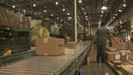 Stock Video Footage of Panoramic view of A Conveyer Belt As Workers Pack Mercandise