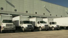 Freight Trucks Lined Up At Warehouse Freight Doors - stock footage