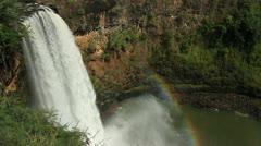 Kauai Hawaii raging water fall with rainbow Stock Footage