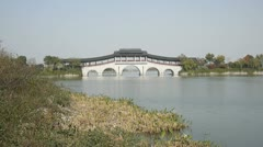 Traditional white stone bridge with arch in china Stock Footage