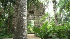 Mayan ruins & Spanish ruins dolly shot through trees Stock Footage