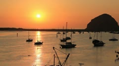Morro Bay California at sunset with boats Stock Footage