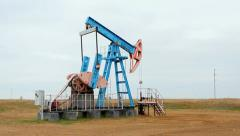 Oil and gas industry. Work of oil pump jack on a oil field. Stock Footage