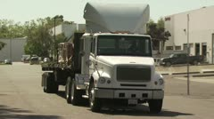Flatbed Truck Leaving a Warehouse Stock Footage