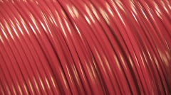 Stock Video Footage of Huge Spinning Spool Of Organge Wire