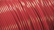 Huge Spinning Spool Of Organge Wire Stock Footage