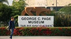 LA Brea TarPits entrance sign in Los Angeles 2 Stock Footage