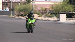 Motorcyle Rider Stands On Moving Cycle Stock Footage