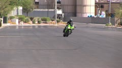 Motorcycle Rider Doing a Front Tire Wheelie on A High Performance Motorcycle Stock Footage