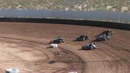 Stock Video Footage of Aerial View of Cars Racing on A Dirt Track