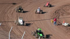 Aerial View of A Flagman on the Track With Cars Whizzing By Stock Footage