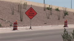Two Safety Barrels and A Traffic Control Sign On The Freeway Stock Footage