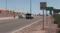 Multiple Traffic Control Signs Along A Freeway On Ramp; Safety Barrels in the Stock Footage