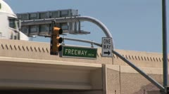 Up View of A Street Sign and Traffic Light Stock Footage