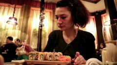 Woman eating sushi in a Japanese restaurant Stock Footage