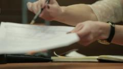 Girl gives documents for signature Stock Footage