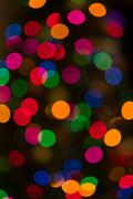 Artistic style defocused abstract background of colored lights - stock photo