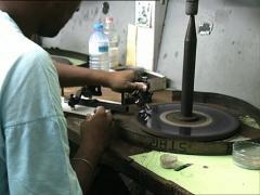 MAURITIUS man cutting diamonds - stock footage
