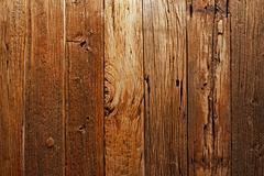 Description for over 100 years old wooden surface. Stock Photos
