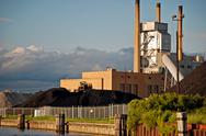 Power plant with coal pile Stock Photos