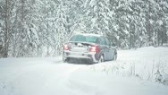 Car stalled on a country road in heavy snow Stock Footage