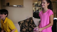 Kids playing XBox Video Games Stock Footage
