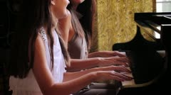 Mother and Daughter Playing the Piano - stock footage