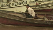 Stock Video Footage of Man Steering a Small Boat Out Onto the Amazon River