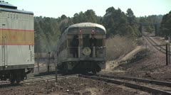 View of the Caboose of a Train With Two People Standing On the Platform Stock Footage