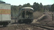 Stock Video Footage of View of the Caboose of a Train With Two People Standing On the Platform